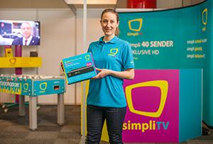 SimpliTV Infostand mit Mitarbeiterin